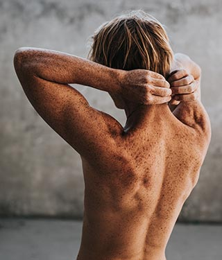 Mole check on freckled back | Meyer Clinic